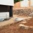 Trabajo de construcción de muro de piedra natural realizado por EXCAVACIONES JODAR para CLIENTE PARTICULAR